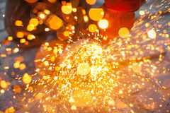 Cuts metal. Angular grinding machine cuts metal with sparks Royalty Free Stock Photo