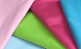 Cuts of multicolored silk fabric background royalty free stock photo