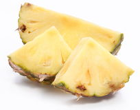 Cuts of pineapple. Isolated on a white background Royalty Free Stock Images