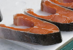 Cuts of Red Salmon. For sale. This fish is for sale in a wet market royalty free stock images