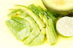 Cutted avocado and lime Royalty Free Stock Photo