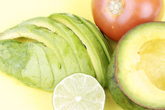 Cutted avocado,tomato and lime Stock Photo