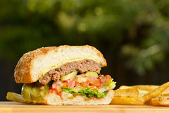 Cutted burger with melted cheese and thick Royalty Free Stock Image