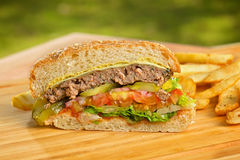 Cutted burger with melted cheese and thick Royalty Free Stock Photos