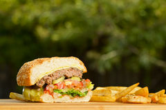 Cutted burger with melted cheese and thick Royalty Free Stock Photography