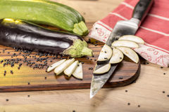Cutted eggplant slices, kitchen knife. Stilllife with cutted eggplant slices, kitchen knife Stock Image