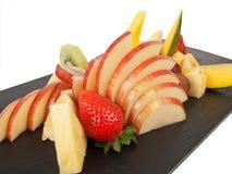 Cutted frukt på en platta Royaltyfri Bild