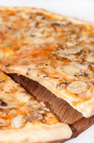 Cutted funghi pizza on the wooden board Royalty Free Stock Photos