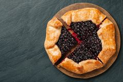 Cutted galette with seasonal berries. Flat lay crispy summer berry pie on a background with copy space royalty free stock photo