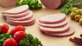 Cutted Ham Sausage on kraft paper background. Vegetables Cutted Ham Sausage on kraft paper background, selective focus Royalty Free Stock Image