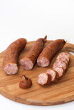 Cutted homemade smoked sausage on a kitchen wooden board Stock Photos