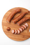 Cutted homemade smoked sausage on a kitchen wooden board Stock Photo