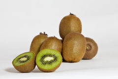 Cutted kiwi. Many Kiwis with one sliced Kiwi in front royalty free stock image