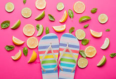 Cutted lemons and limes and beach shoes Stock Photo