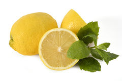 Cutted lemons with a piece of mint Royalty Free Stock Photography