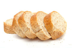 Cutted long loaf with bran Royalty Free Stock Photos