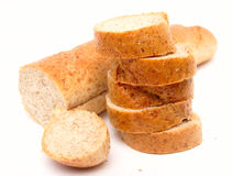 Cutted long loaf with bran Stock Images