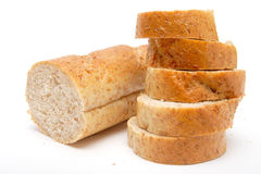 Cutted long loaf with bran Stock Image