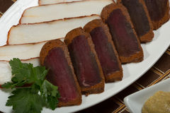 Cutted meat and lard on a plate Stock Images