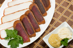 Cutted meat and lard on a plate Royalty Free Stock Images