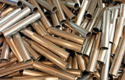 Cutted metal pipes. Cutted white metal short pipes in bulk Stock Image