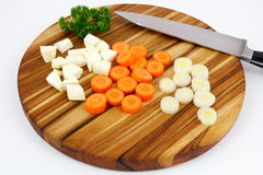 Cutted mirepoix on wooden cutting board Stock Images