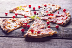 Cutted Pizza on wooden table Stock Image