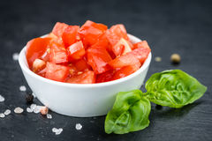 Cutted Tomatoes on a vintage slate slab selective focus Stock Image