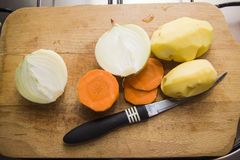 Cutted  vegetables and knife Royalty Free Stock Image