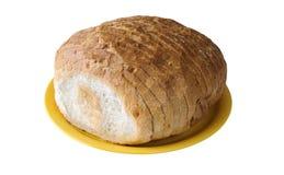 Cutted vitt bröd på den gula plattan Arkivbild