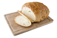 Cutted vitt bröd på träbrädet Royaltyfri Bild