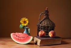 Cutted watermelon, sunflower blossom Stock Photos