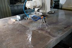 Cutter close-up. Jets of water. Machine for industrial processing of stone royalty free stock images