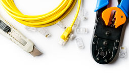 Cutter, crimper, yellow patch cord and connectors Stock Photo