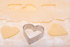 Cutter an dough in heart shape Stock Photo