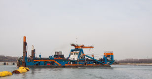 A cutter dredger at work. In Holland stock photography