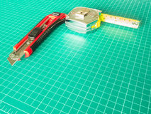 Cutter on green grid cutting pad Stock Image