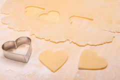Cutter with heart shape of dough Royalty Free Stock Image