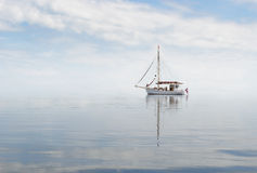 Cutter in misty sea. Stock Photos