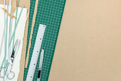 Cutter, ruler, scissors pencil and cutting mat on recycled paper Royalty Free Stock Photos