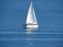 Cutter sailboat in open sea Royalty Free Stock Photography