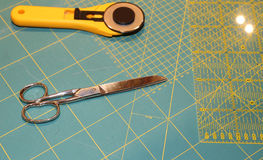 Cutter and scissors on the worktop Stock Images