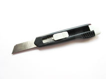 Cutter. A sharp steel cutter used for cutting objects isolated on white Royalty Free Stock Images