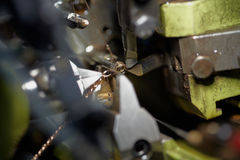 Cutter and wire in automatic chain-bending machine Stock Photo