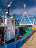 Cutters berthed at the port Stock Photo