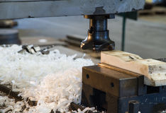 Cutters milling machine with scrap. Cutters milling machine with polymer scrap Royalty Free Stock Photos
