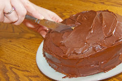 Cutting A Chocolate Cake Royalty Free Stock Image