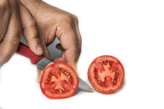 Free Cutting A Tomato Royalty Free Stock Photos - 68235658