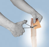 Cutting adhesive bandage. With scissors Stock Photography