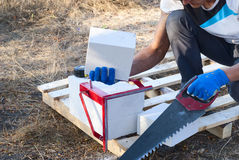 Cutting aerated concrete Stock Image